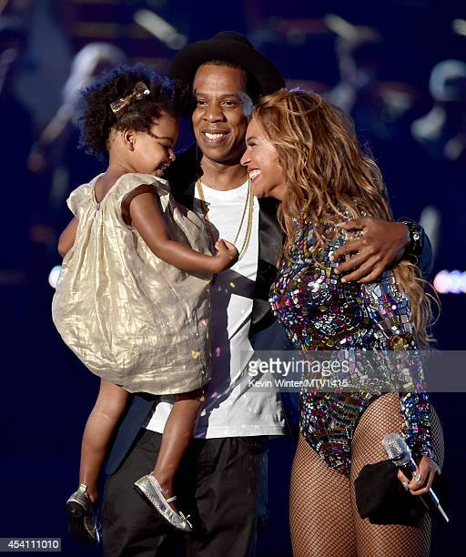 Rapper Jay Z and singer Beyonce with daughter Blue Ivy Carter onstage during the 2014 MTV Video Music Awards at The Forum on August 24 2014 in...