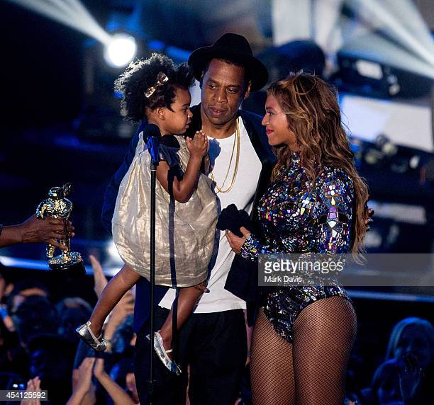 Rapper Jay Z and singer Beyonce with daughter Blue Ivy Carter onstage during the 2014 MTV Video Music Awards at The Forum on August 24, 2014 in...