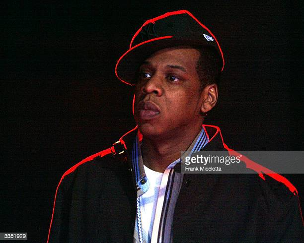 Rapper Jay Z waits backstsage before his name is announced at the 2nd Annual TRL Awards at MTV Times Square Studios April 13 2004 in New York City...