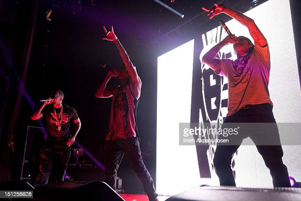 Rapper Jayceon Terrell Taylor aka The Game rapper Michael Ray NguyenStevenson aka Tyga and singer Chris Brown perform at the 2012 Closer To My Dreams...