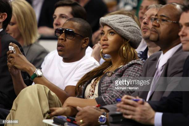 Rapper JayZ and his wife singer Beyonce watch from the front row as the Cleveland Cavaliers take on the Boston Celtics during Game Five of the...