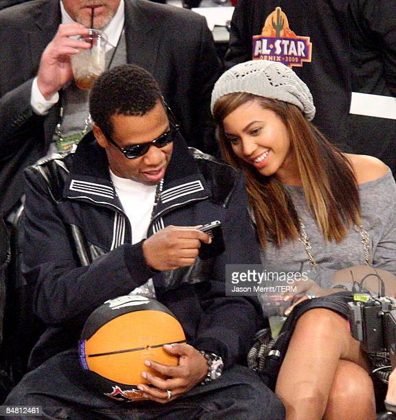 Rapper JayZ and singer Beyonce Knowles sit in the audience during the 58th NBA AllStar Game part of 2009 NBA AllStar Weekend at US Airways Center on...