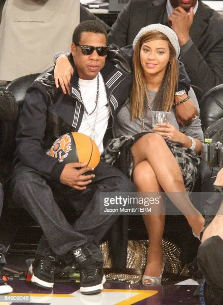 Rapper Jay-Z and singer Beyonce Knowles sit in the audience during the 58th NBA All-Star Game, part of 2009 NBA All-Star Weekend at US Airways Center...