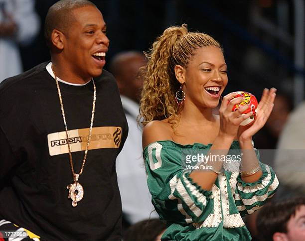 Rapper JayZ and singer Beyonce Knowles watch the action during the 2003 NBA AllStar game at the Phillips Arena February 9 2003 in Atlanta Georgia