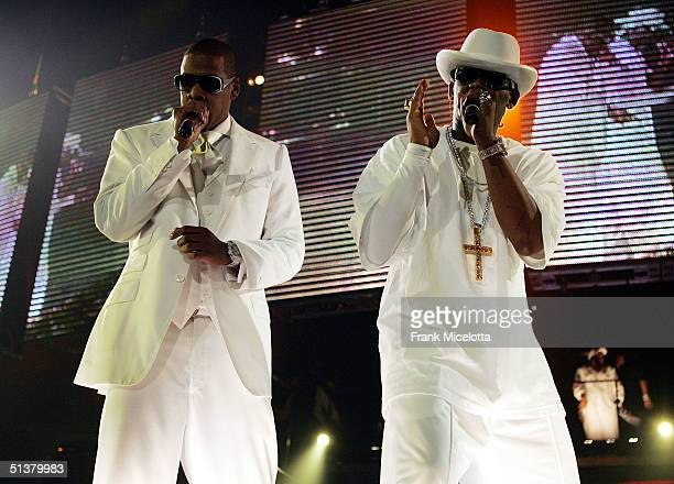 Rapper JayZ and singer R Kelly perform during their Best of Both Worlds tour September 30 2004 at the Allstate Arena in Rosemont Ill