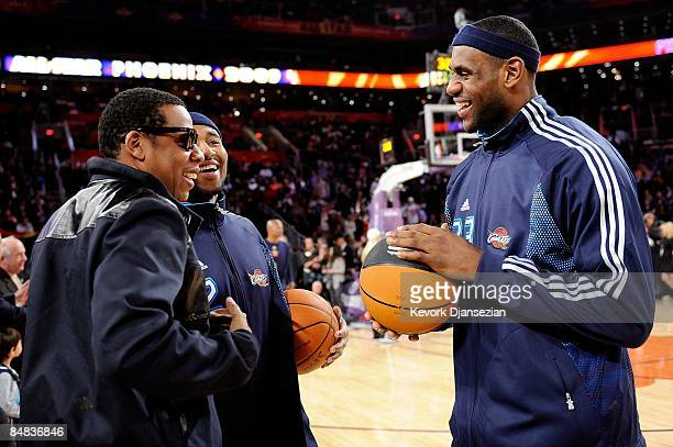 Rapper Jay-Z talks to Mo Williams and LeBron James of the Eastern Conference during the 58th NBA All-Star Game, part of 2009 NBA All-Star Weekend at...