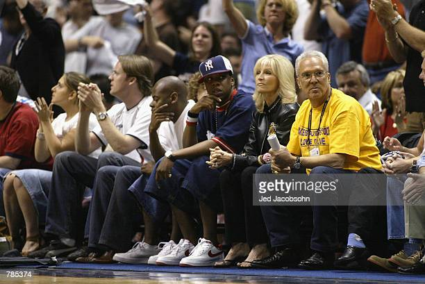 Rapper JayZ watches the the Los Angeles Lakers take on the New Jersey Nets in Game three of the 2002 NBA Finals at Continental Airlines Arena in East...