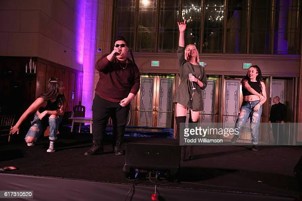Rapper Jovan Armand and singer Mahkenna perform onstage at Starlight's Dream Halloween 2016 on October 22 2016 in Los Angeles California