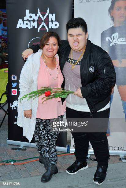 Rapper Jovan Armand with his mother Virginia Arlene at Mother's Day Night Out Concert at Surf City Nights on May 9 2017 in Huntington Beach California