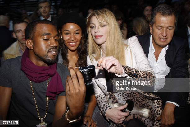 Rapper Kanye West and his fiance Alexis Phifer Courtney Love and fashion photographer Mario Testino attend the Givenchy fashion show during the Paris...