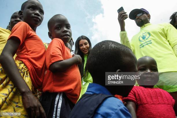 US rapper Kanye West and his wife Kim Kardashian visit an orphanage run by Uganda Womens Effort to Save Orphans in the town of Masulita about 40...