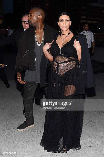 Rapper Kanye West and television personality Kim Kardashian attend the Givenchy fashion show during Spring 2016 New York Fashion Week at Pier 26 at...