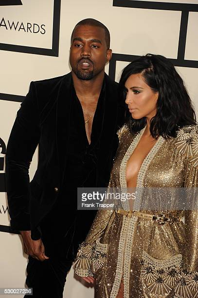 Rapper Kanye West and TV personality Kim Kardashian arrive at The 57th Annual GRAMMY Awards held at the Staples Center