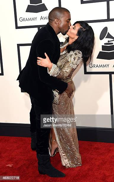 Rapper Kanye West and TV personality Kim Kardashian attend The 57th Annual GRAMMY Awards at the STAPLES Center on February 8 2015 in Los Angeles...