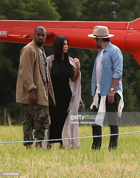 US rapper Kanye West and wife Kim Kardashian arrive in a helecopter at the Glastonbury Festival at Worthy Farm Pilton on June 27 2015 in Glastonbury...