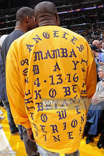 Rapper Kanye West attends the Utah Jazz game against the Los Angeles Lakers wearing a customized Kobe Bryant shirt at STAPLES Center on April 13 2016...