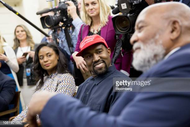 Rapper Kanye West center smiles as former American football player Jim Brown right speaks during a meeting with US President Donald Trump not...