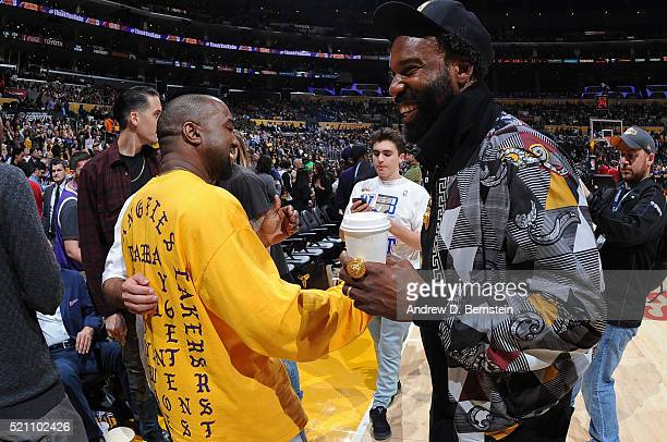 ca07bb7ed76a Rapper Kanye West hugs former NBA player Baron Davis after the Utah Jazz  play against the