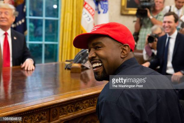 Rapper Kanye West laughs during a meeting with President Donald Trump in the Oval Office of the White House in Washington D.C. On October 11, 2018.