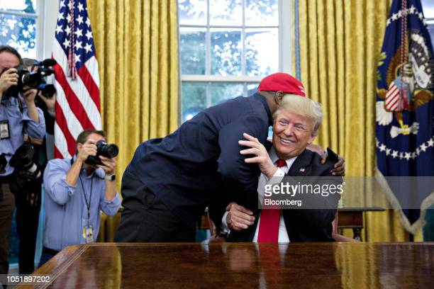 Rapper Kanye West, left, hugs U.S. President Donald Trump during a meeting in the Oval Office of the White House in Washington, D.C., U.S., on...