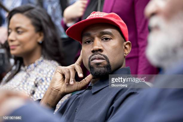 Rapper Kanye West listens during a meeting with US President Donald Trump not pictured in the Oval Office of the White House in Washington DC US on...