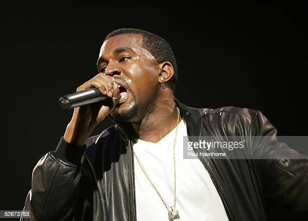 Rapper Kanye West performs at the HM Live From Central Park fashion show April 20 2005 in New York City
