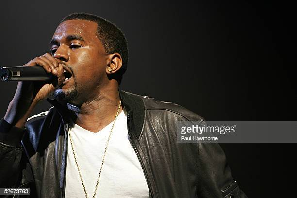 Rapper Kanye West performs at the 'HM Live From Central Park' fashion show April 20 2005 in New York City