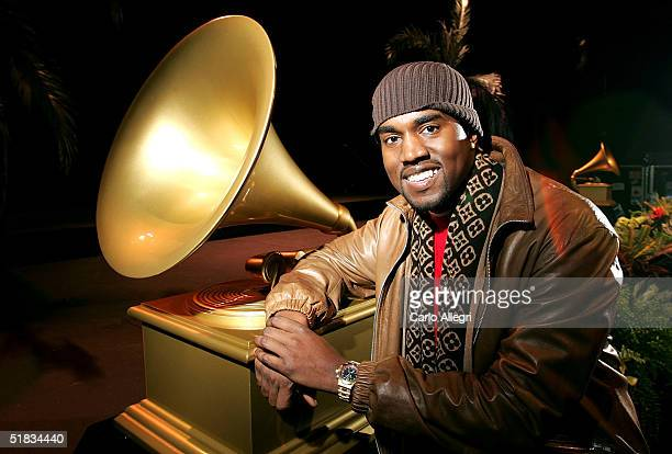 Rapper Kanye West poses for photos after receiving 10 Grammy nominations at the 47th Annual GRAMMY Awards at The Music Box December 7 2004 in...