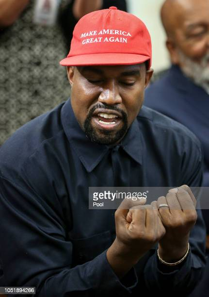 Rapper Kanye West speaks during a meeting with US President Donald Trump in the Oval office of the White House on October 11 2018 in Washington DC