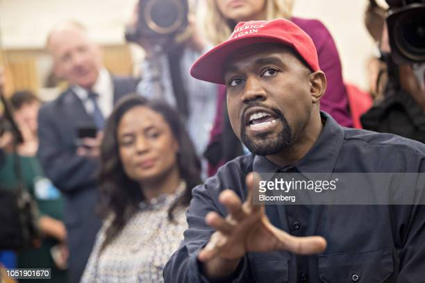 Rapper Kanye West speaks during a meeting with U.S. President Donald Trump, not pictured, in the Oval Office of the White House in Washington, D.C.,...