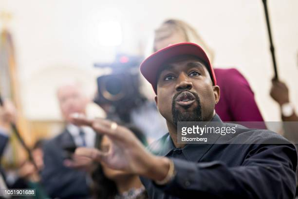 Rapper Kanye West speaks during a meeting with US President Donald Trump not pictured in the Oval Office of the White House in Washington DC US on...