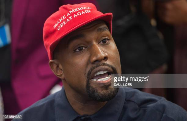 Rapper Kanye West speaks during his meeting with US President Donald Trump in the Oval Office of the White House in Washington DC on October 11 2018