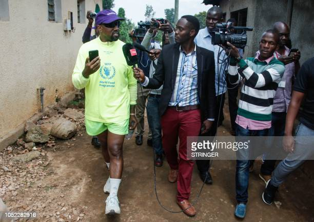 US rapper Kanye West speaks to medias as he visits an orphanage run by Uganda Womens Effort to Save Orphans in the town of Masulita about 40...