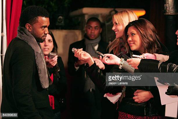 Rapper Kanye West speaks to reporters at Flaunt Magazine's 10th anniversary and annual holiday toy drive at The Wayne Kao Mansion on December 18,...