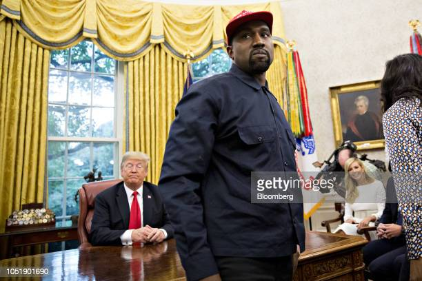 Rapper Kanye West stands during a meeting with US President Donald Trump left in the Oval Office of the White House in Washington DC US on Thursday...