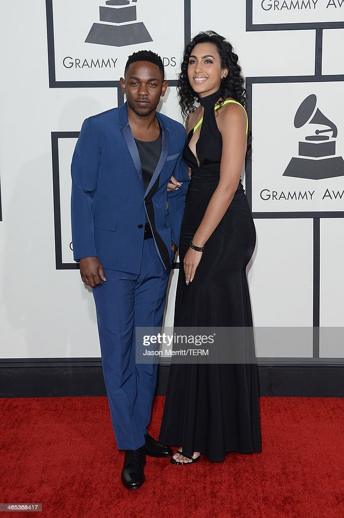 Rapper Kendrick Lamar (L) and guest attend the 56th GRAMMY Awards at Staples Center on January 26, 2014 in Los Angeles, California.