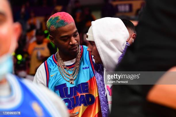 Rapper, Kid Cudi and Singer, Justin Bieber attend a game between the Golden State Warriors and the Los Angeles Lakers on October 19, 2021 at STAPLES...