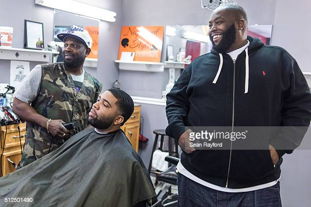 Rapper Killer Mike right talks about the upcoming South Carolina Democratic presidential primary at Smoke's Barber Shop as Donnell McDaniel left...