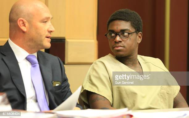 Rapper Kodak Black right speaks with his attorney during a sentencing hearing in connection with the violation of his house arrest in Fort Lauderdale...
