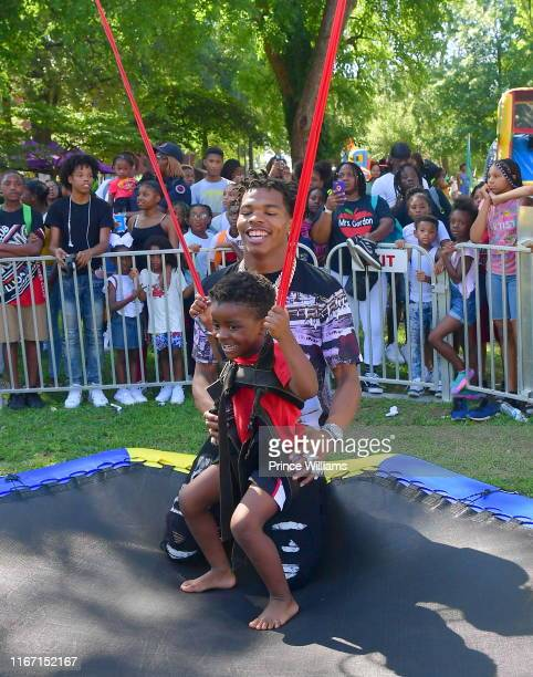 Rapper Lil Baby and His Son Jason attend The Grand Finale Summer 19 Back to School Drive at Morris Brown College on August 9 2019 in Atlanta Georgia