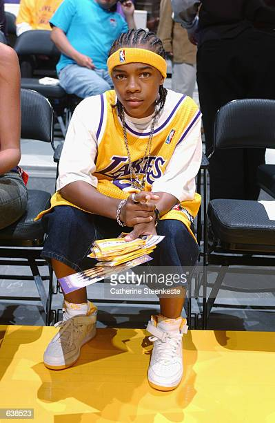 Rapper Lil' Bow Wow watches the Sacramento Kings take on the Los Angeles Lakers in Game six of the Western Conference Finals during the 2002 NBA...
