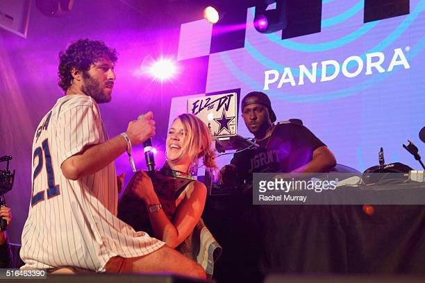 Rapper Lil Dicky and volunteer SXSWer perform a mock 'lap dance' onstage during the PANDORA Discovery Den SXSW on March 18 2016 in Austin Texas