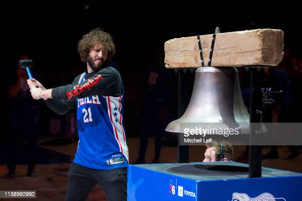 Rapper Lil Dicky rings the bell prior to Game Five of Round One of the 2019 NBA Playoffs between the Brooklyn Nets and Philadelphia 76ers at the...