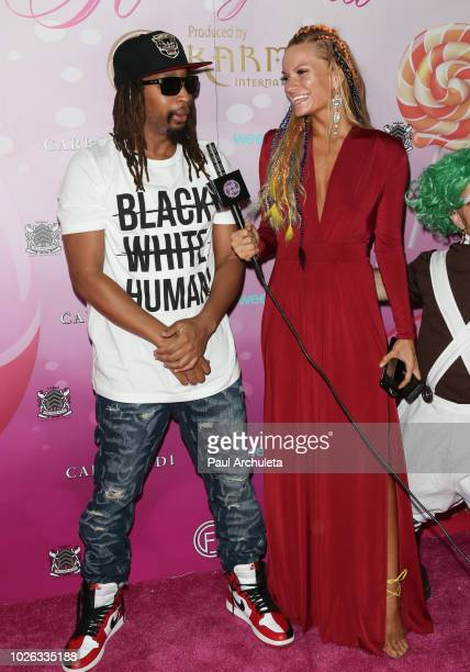 Rapper Lil Jon and Actress/model Caitlin O'Connor attend the Karma International Kandyland event at Boulevard 3 on August 25 2018 in Hollywood...
