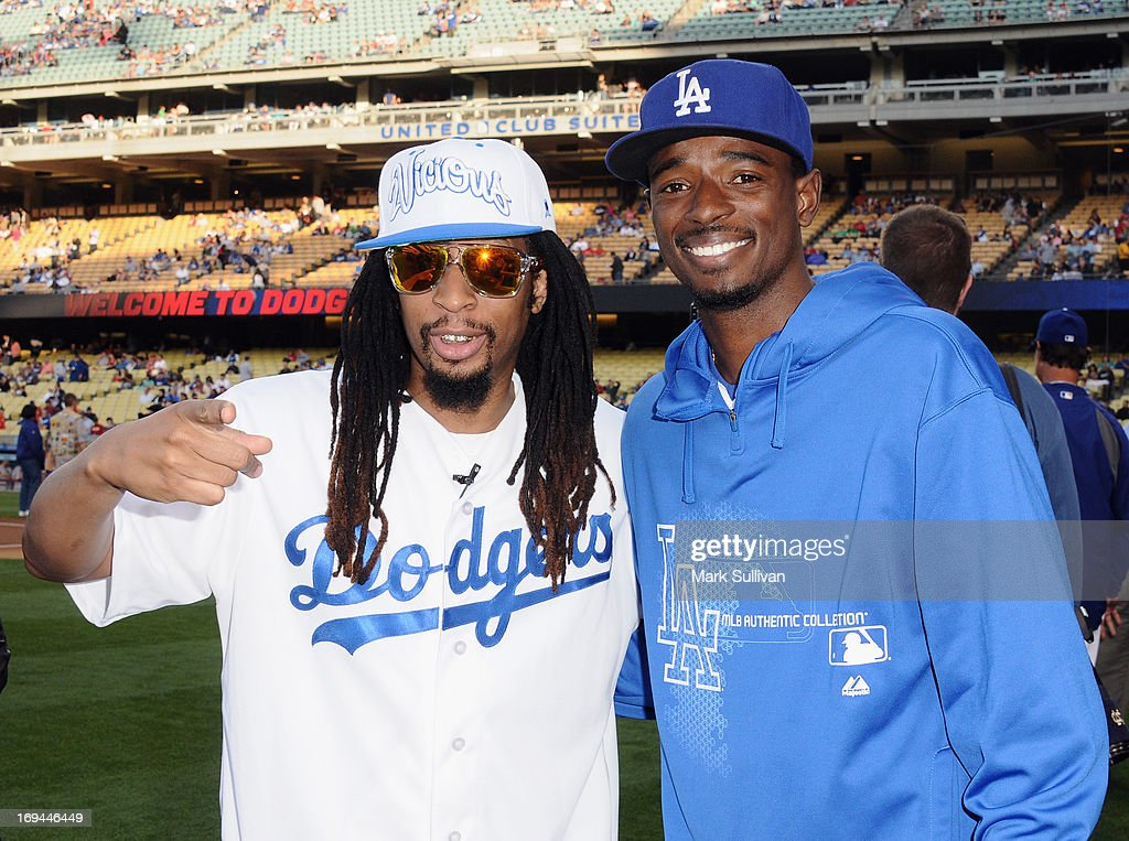 Rapper Lil' Jon (L) and Los Angeles Dodger infielder Dee Gordon pose on the field before throwing out the ceremonial first pitch before the game between the St. Louis Cardinals and the Los Angeles Dodgers at Dodger Stadium on May 24, 2013 in Los Angeles, California.