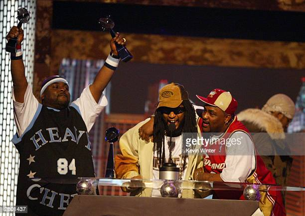 Rapper Lil Jon and the East Side Boyz accept their award onstage during the 2003 Billboard Music Awards at the MGM Grand Garden Arena December 10...