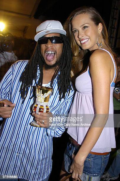 Rapper Lil' Jon gets together with supermodel Petra Nemcova backstage during designer Tommy Hilfiger's Fashion Week runway show at the Tent in Bryant...