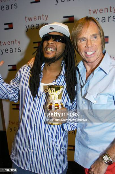 Rapper Lil' Jon gets together with Tommy Hilfiger backstage at the Tent in Bryant Park during the designer's Fashion Week runway show The show which...