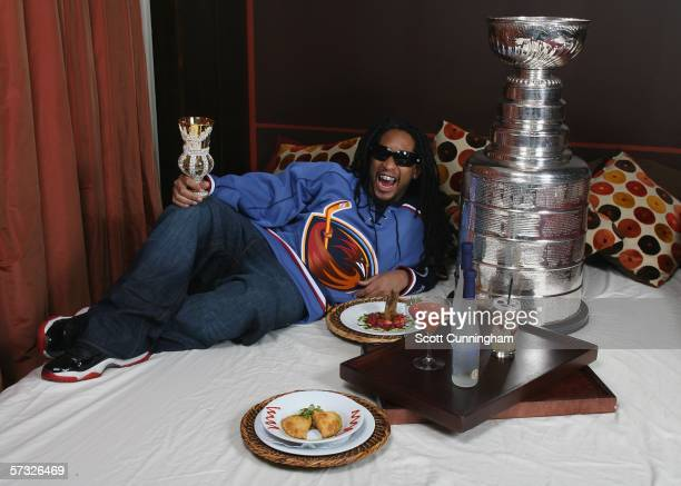 Rapper Lil' Jon poses with the Stanley Cup at the club bed in Atlanta April 11 2006 in Atlanta Georgia The Thrashers won the game 52