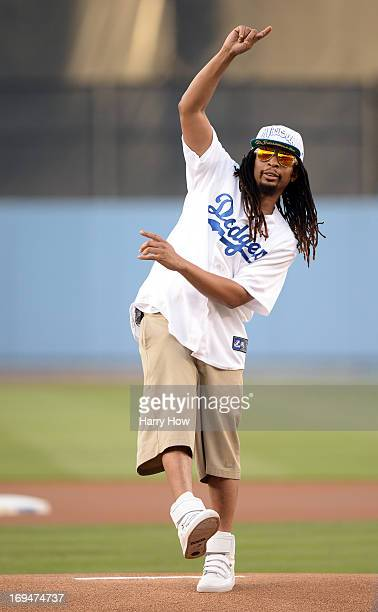 Rapper Lil Jon reacts to his ceremonial first pitch before the game between the St Louis Cardinals and the Los Angeles Dodgers at Dodger Stadium on...